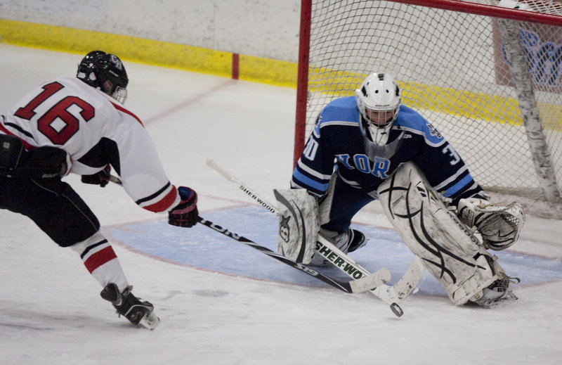 Jack Orne, who scored four goals in his team's 8-4 win, tries unsuccessfully for a fifth but is stopped by York goaltender Jared Posternak late in the third period of Friday's game in Lewiston.