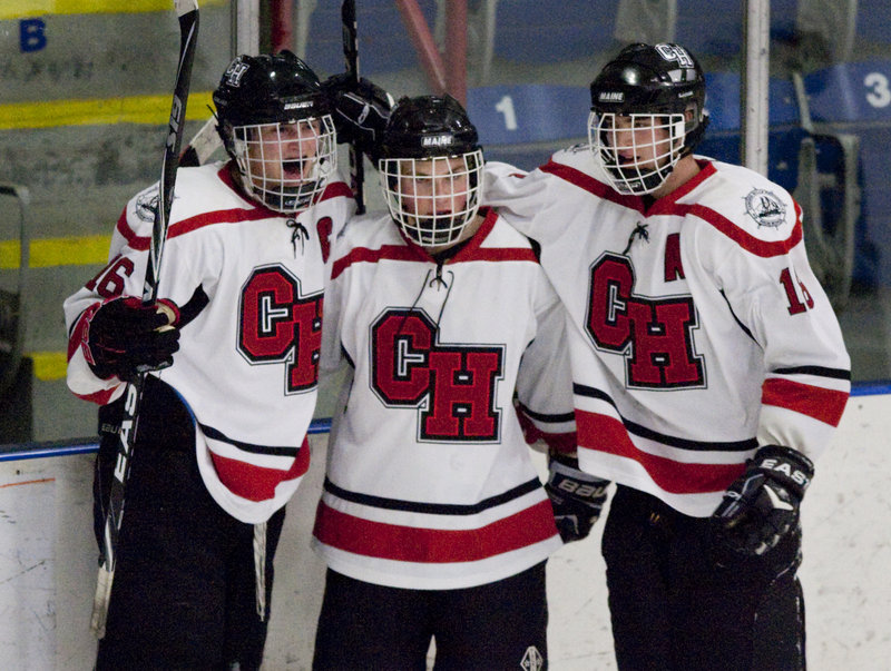 Camden Hills captain Jack Orne, left, celebrates with teammates after scoring his fourth goal in the Western Class B boys' hockey semifinals Friday at the Colisee in Lewiston, sending the Windjammers to the regional final for the first time in their seven-year varsity hockey program.