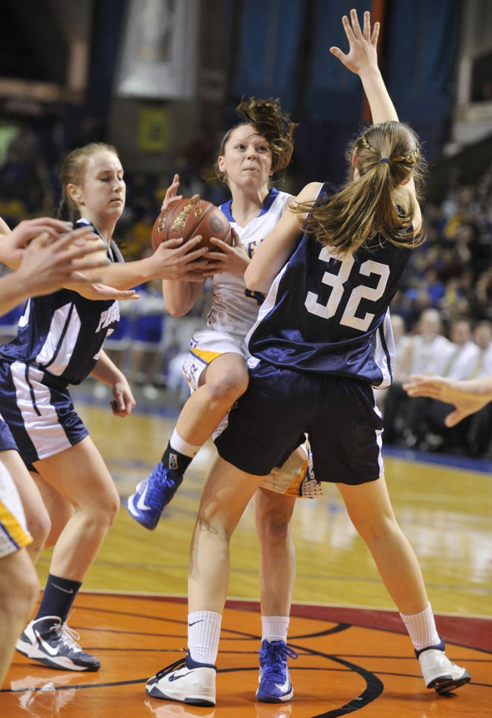Sydney Hancock of Lake Region finds herself out of room Friday night while driving the lane against Hannah Graham of Presque Isle during Presque Isle's 51-44 victory in the Class B state championship game at the Cumberland County Civic Center.