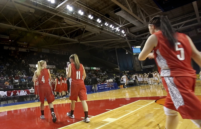 "From left, seniors Maria Philbrick, Taylor LeBorgne and Mary Redmond return to the court after halftime in their semifinal Feb. 22 against McAuley. McAuley won, 47-38, ending Scarborough's season and its quest for the gold ball. But senior Marisa O'Toole said, ""I think we played our hearts out."""
