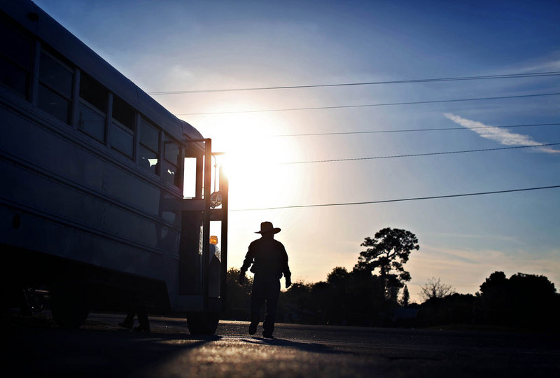 A farmworker is dropped off in a parking lot after a day of work in Immokalee, Fla. The state's largest agricultural trade group estimates that 75 percent of its workers are undocumented.