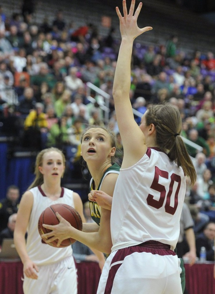 Olivia Smith looks for an opening against Bangor's Cordelia Stewart in the Class A state championship game Saturday. Smith scored 20 points in McAuley's 60-45 victory.