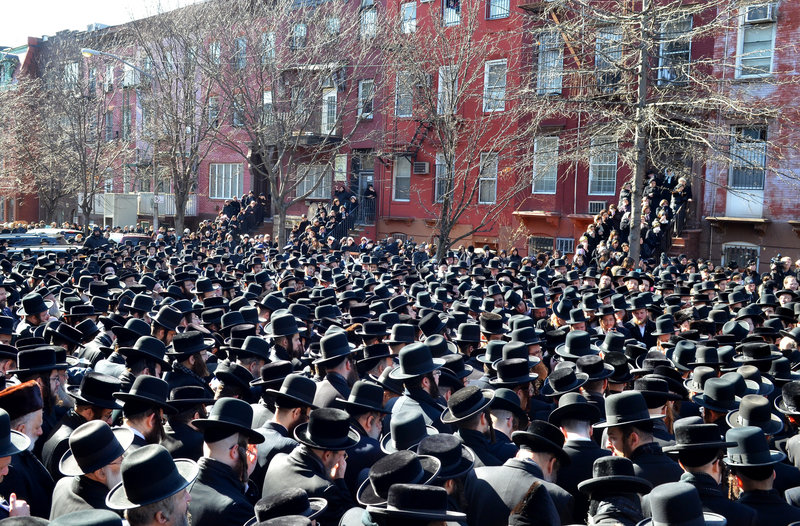 Orthodox Jewish mourners gather outside the Congregation Yetev Lev D'Satmar synagogue in Brooklyn's Williamsburg neighborhood Sunday for the funeral of two expectant parents who were killed in a car accident earlier in the day in New York. The baby of Nachman and Raizy Glauber was delivered prematurely, but died around 5:30 a.m. Monday.