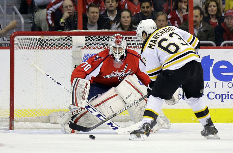 Boston's Brad Marchand scores on a penalty shot against Washington goaltender Braden Holtby during first-period action of Tuesday's game in Washington, won in overtime by the Capitals.