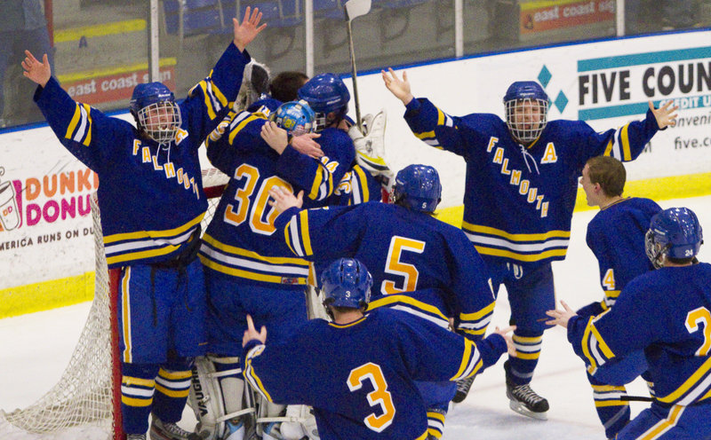 Falmouth celebrates after beating Scarborough 4-3 for the Class A Western Maine finals in Lewiston on Tuesday.