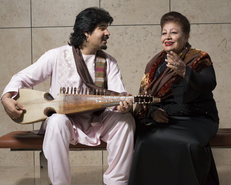 Homayoun Sakhi, left, is a master of the rubab, an Afghan lute that dates back 2,000 years. He leads the band Voices of Afghanistan, which is fronted by vocalist Farida Mahwash, right.