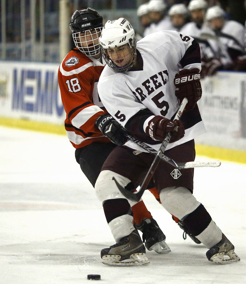 Grayson Szumilas of Camden Hills attempts to work his way around Brian Storey of Greely. Szumilas had his team's goal.