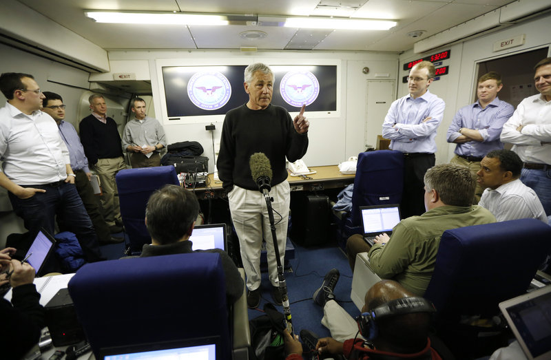 Defense Secretary Chuck Hagel speaks to the traveling press aboard his military aircraft, en route to Afghanistan on Friday.