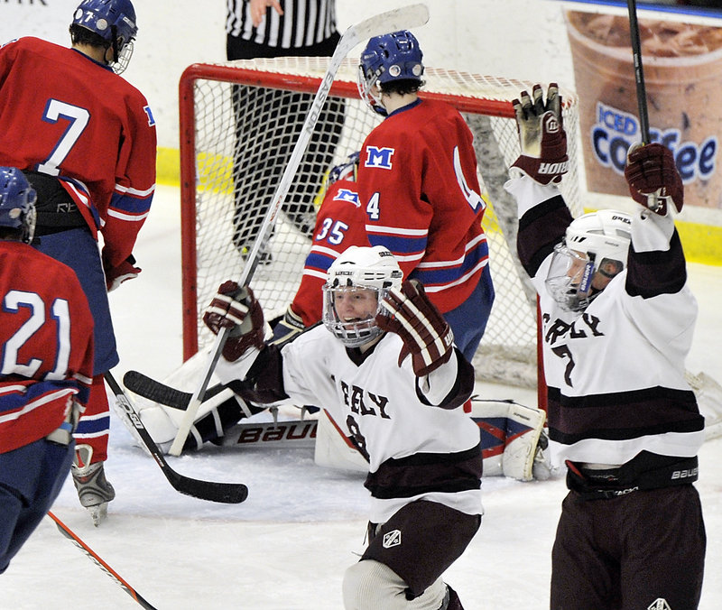 Reid Howland, left, and Mitchel Donovan of Greely show their joy as the Rangers moved a step closer to the state title with their second goal in what turned out to be a 3-0 victory against Messalonskee.