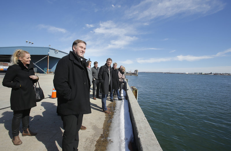 Gylfi Sigfusson, second from left, president and CEO of Eimskip Logistic Services Inc., tours the International Marine Terminal in Portland along with 17 other Eimskip managers on Saturday.