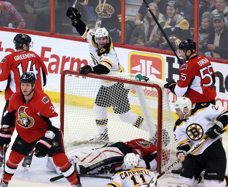 Boston's Daniel Paille celebrates a goal during the first period of the Bruins' game against the Ottawa Senators on Monday in Ottawa, The Bruins won in a shootout, 3-2.