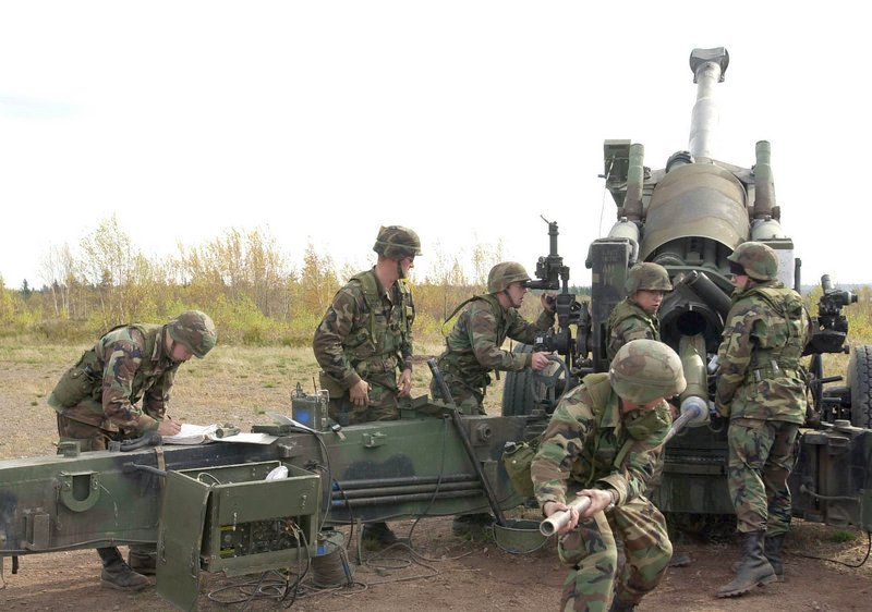 In this October 2001 file photo, Maine Army National Guardsmen load a round into a Howitzer gun on Saturday during training at the Canadian Forces Base Gagetown in New Brunswick, Canada. The guardsmen belonged to the Alpha Battery of the 1st Battalion, 152 Field Artillery.