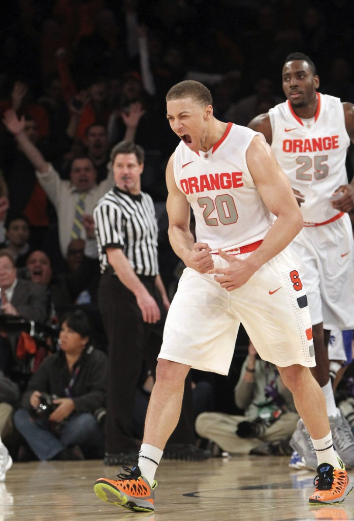Brandon Triche keyed a big second-half run Wednesday as Syracuse beat Seton Hall to advance to the Big East quarterfinals at Madison Square Garden.