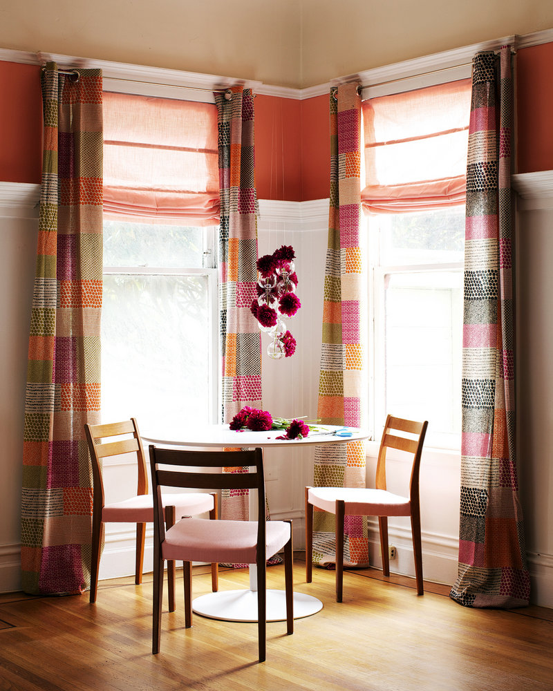 "In his book ""The First Apartment Book: Cool Design for Small Spaces,"" Kyle Schuneman recommends boldly patterned drapes, above, and carpeting and upholstery, below."