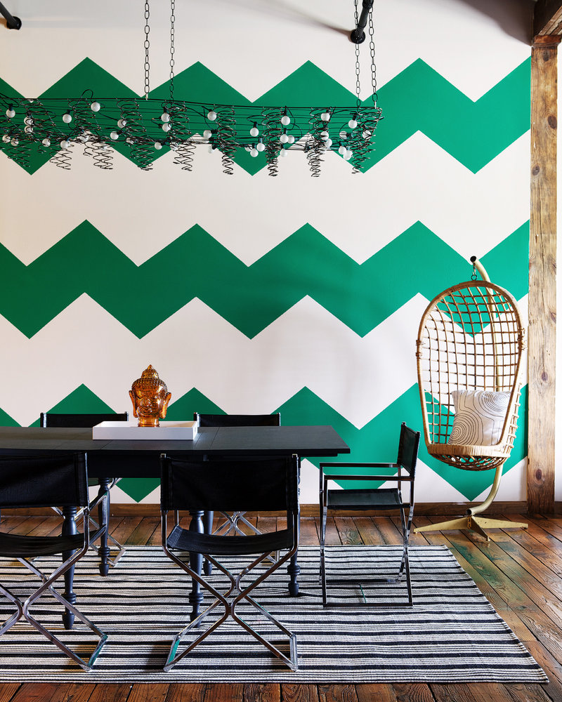 "Stencils create the look of patterned wallpaper for a burst of color, as seen in ""The First Apartment Book: Cool Design for Small Spaces,"" by Kyle Schuneman."