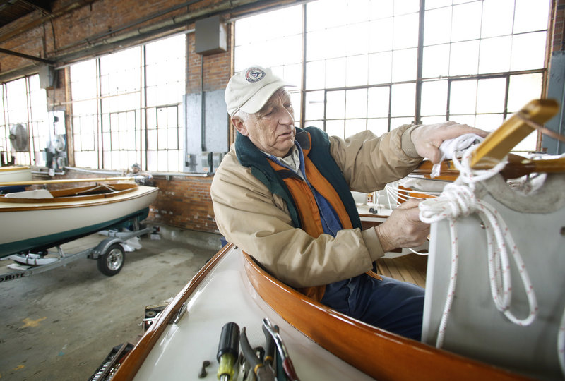 Gordon Goodwin of Cape Cod Shipbuilding Co. begins to rig a Herreshoff H-12 1/2 as exhibitors prepare for the Maine Boatbuilders Show at the Portland Complex in Portland on Thursday afternoon on March 14, 2013.