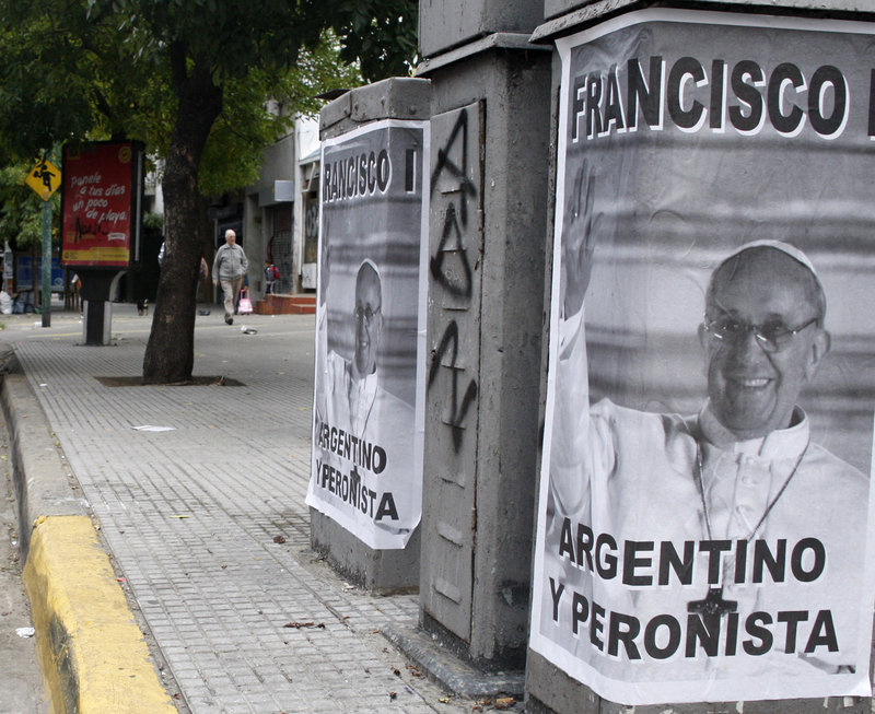 "Posters celebrating the selection of an Argentine pope dot Buenos Aires. A priest at the center of a controversy over the pope's actions during Argentina's so-called ""dirty war"" says he considers the matter closed."