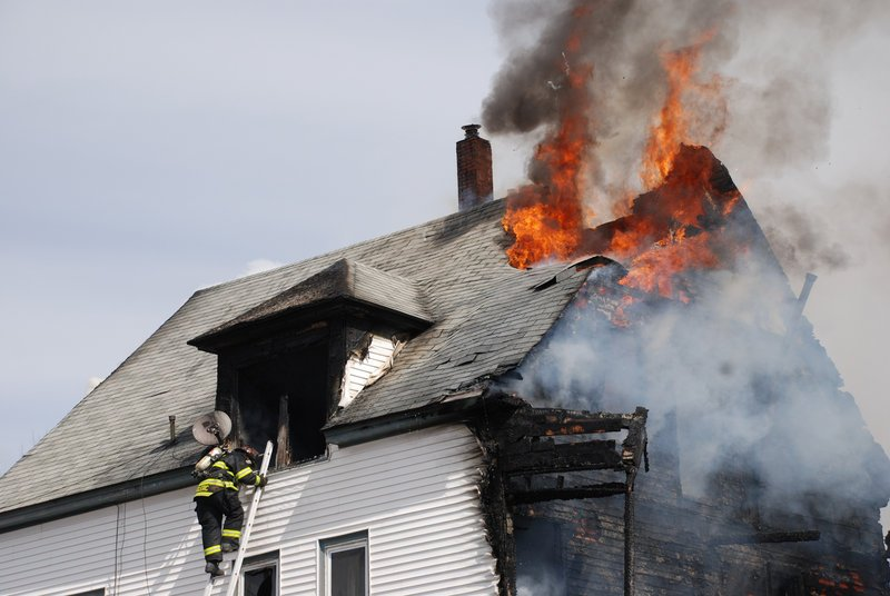 Fire erupts Saturday afternoon from an apartment building at 39 Church St. in Jay, leaving three families homeless.