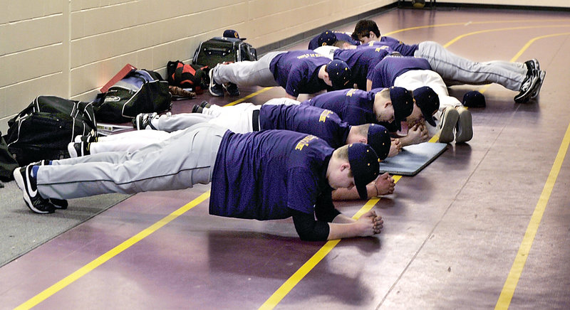 Arm strength is important for pitchers, but so too is overall conditioning as Cheverus players tone up their stomach muscles before they run on the track in the first official day of baseball practice.