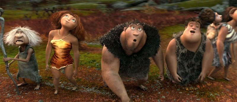 "Gran (left, voiced by Cloris Leachman), Eep (Emma Stone), Grug (Nicolas Cage) and Thunk (Clark Duke) in a scene from ""The Croods."""