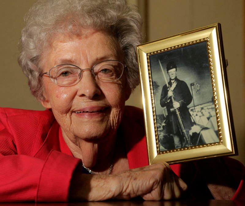 Juanita Tudor Lowrey, 86, holds a photo of her father, Civil War veteran Hugh Tudor. Lowrey received Civil War pension benefits until she was 18.