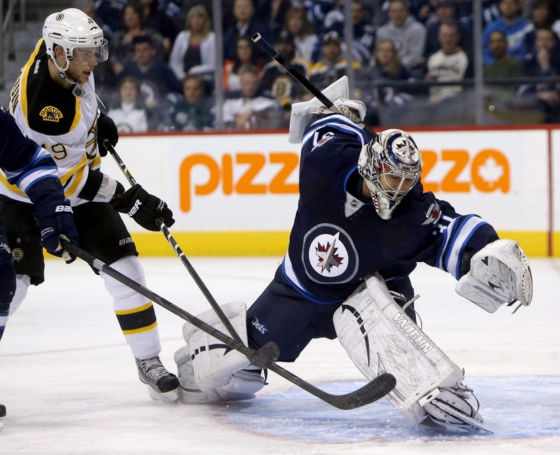 Ondrej Pavelec of the Jets makes a sprawling save with Boston's Tyler Seguin in front of the net during the first period Tuesday night in Winnipeg, Manitoba. The Jets rallied in the third period for a 3-1 win.