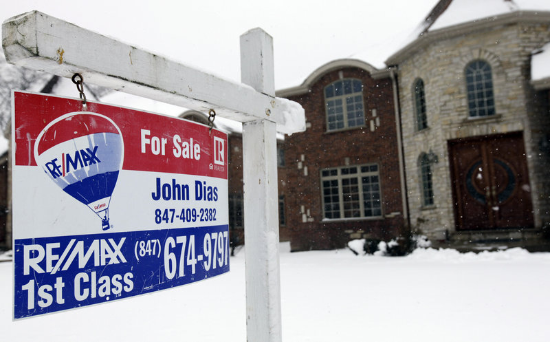 "A ""for sale"" sign is seen outside a home in Glenview, Ill., last month. U.S. sales of previously occupied homes rose in February to the highest level in more than three years."