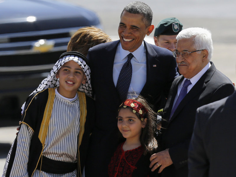 "President Obama and Palestinian President Mahmoud Abbas pose with Palestinian children Thursday after Obama traveled to the West Bank for talks with Palestinian leaders. He urged both sides to shed the ""formulas and habits that have blocked progress for so long."""