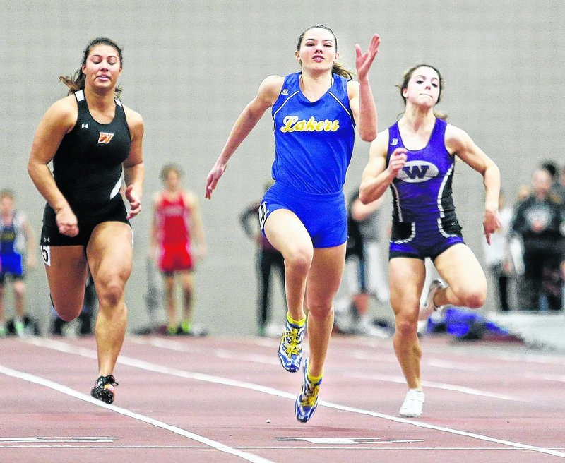 Lake Region's Kate Hall, center, defended three state titles at the Class B meet and went on to eclipse all-time Maine bests in the 55 meters and long jump at the New England championships in Boston.