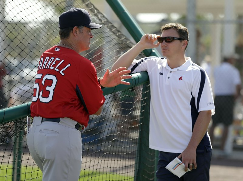 "Red Sox manager John Farrell, left, talks to general manager Ben Cherington after a team workout in Fort Myers, Fla. ""We've had a good spring training,"" Cherington said."