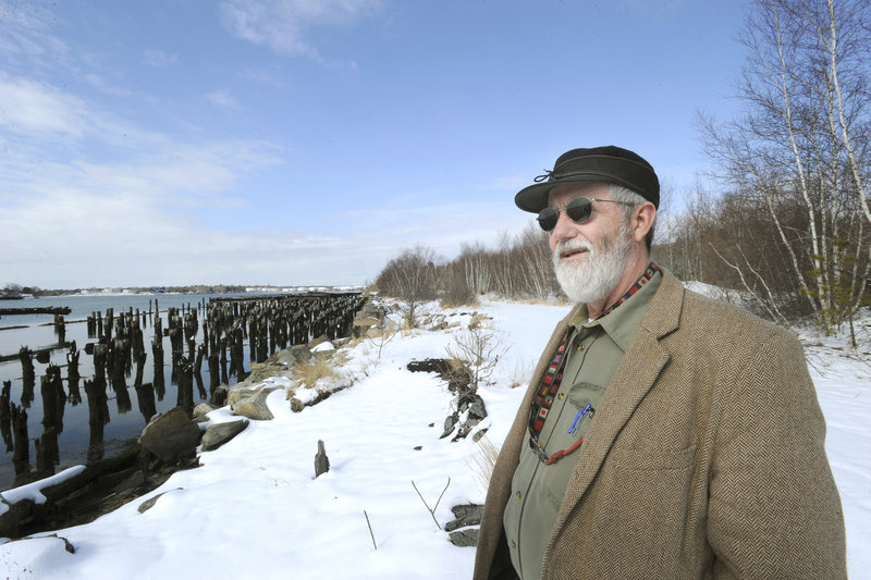 Portland Yacht Services owner Phineas Sprague shows a section of the Portland waterfront where he hopes to build a boatyard.