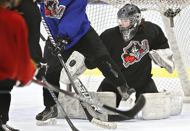 Goalie Devan Kane of Scarborough blocks a puck during practice, as the girls' U19 team gets ready for the upcoming national tournament in early April at San Jose, Calif.
