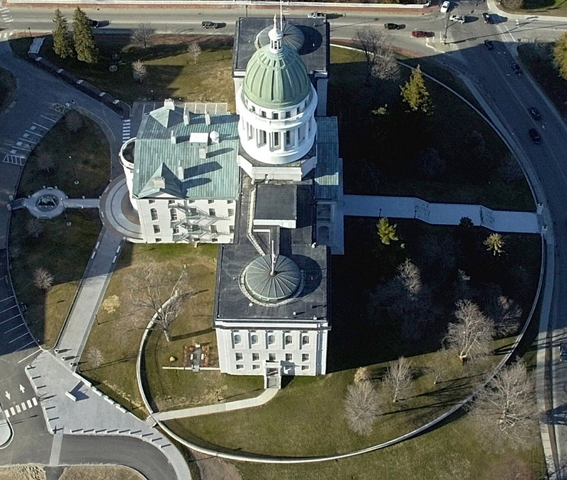 This 2007 file aerial photo shows the Maine State House in Augusta. A $1.2 million project that will turn the State House dome from green to brown still awaits final approval.