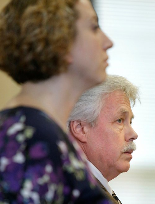 Mark Strong Sr. and his co-counsel Tina Nadeau (foreground) look to the jury as the jury foreman calls out guilty on the thirteen charges against him at York County Superior Court in Alfred on Wednesday. Strong faced 12 counts of promotion of prostitution and one count of conspiracy to promote prostitution for his connection with Alexis Wright, who is accused of running a prostitution business out of her Zumba studio in Kennebunk.