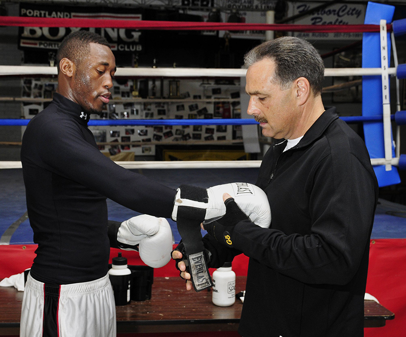 In this April 29, 2008 file photo, Russell Lamour gets help from coach Bobby Russo at the Portland Boxing Club. A week after this photo was taken, Lamour competed in the National Golden Gloves Championship in Utah, where now-dead Boston Marathon bombing suspect Tamerlan Tsarnaev was also a competitor.