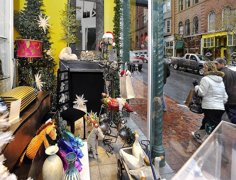 In this November 2011 file photo, an attractive window display by Abacus Gallery on Exchange Street in Portland attracts the shoppers' eye. A new bill would allow Maine stores with less than 10,000 square feet of interior selling space to be open on Easter, Thanksgiving and Christmas.