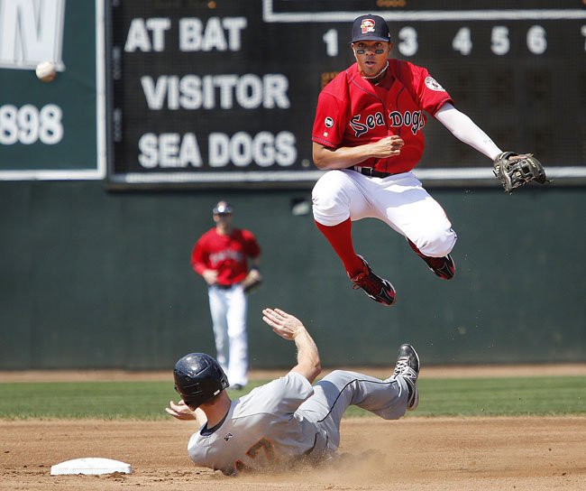 Xander Bogaerts of Portland makes the throw for a double play on August 26, 2012, after forcing out Dustin Martin during the second inning of a home game against Binghampton. Bogaerts, who played 23 games for Portland at the end of last season, batting .326, returns this year.