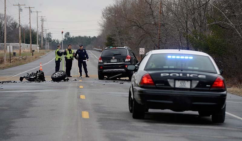 An accident reconstruction team examines the scene of a fatal crash on Route 4 in Berwick last Wednesday.
