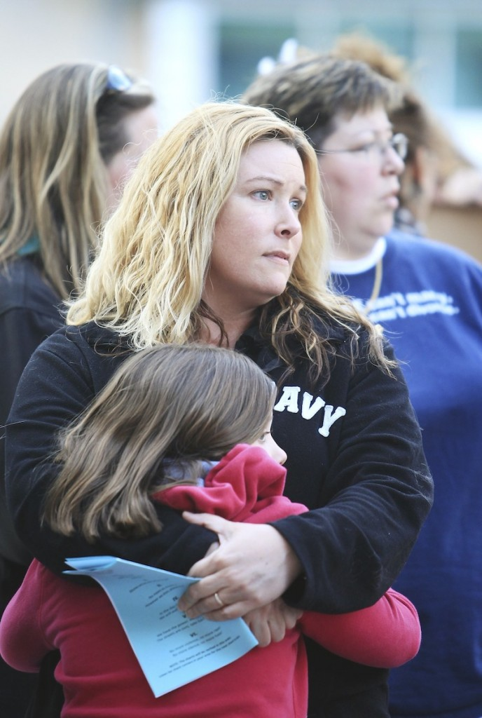 Jenny Berube of Sanford hugs her daughter, Ari, 10, while attending the Take Back the Night rally and march at Monument Square in Portland Friday, April 26, 2013.