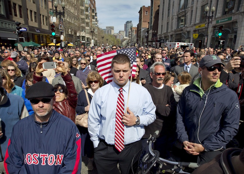 A moment of silence in honor of the victims of the Boston Marathon bombing is observed on Boylston Street near the race finish line, exactly one week after the tragedy, Monday, April 22, 2013, in Boston, Mass. (AP Photo/Robert F. Bukaty)