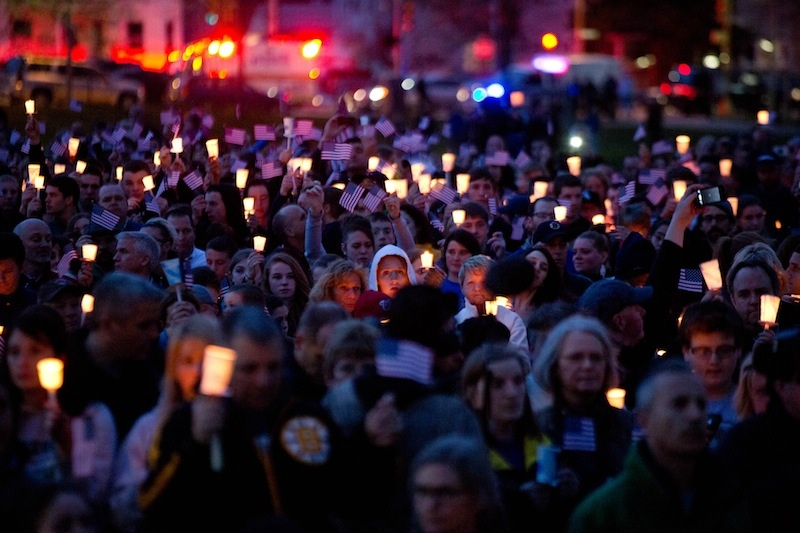 Mourners attend candlelight vigil for Martin Richard at Garvey Park, near Richard's home in the Dorchester section of Boston, on Tuesday, April 16, 2013. Martin is the 8-year-old boy killed in the Boston Marathon bombing. (AP Photo/The New York Times, Josh Haner) Merlin ID:68234504;20130416;NYTREMOTE