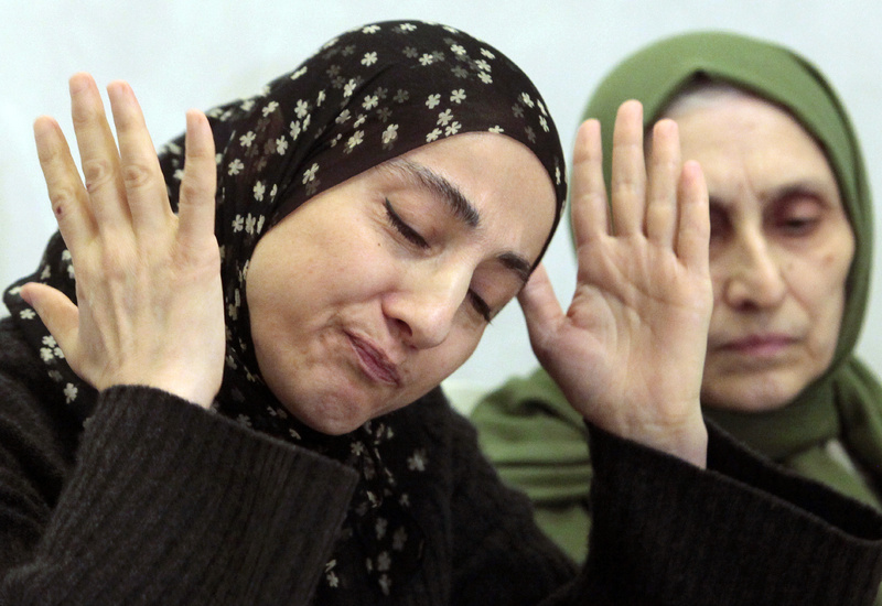 Zubeidat Tsarnaeva, the mother of the two Boston bombing suspects, speaks at a news conference as her sister-in-law, Maryam, listens in Makhachkala, in the southern Russian province of Dagestan, on Thursday.