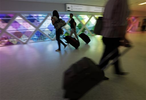 Passengers travel through an airport in Miami recently.