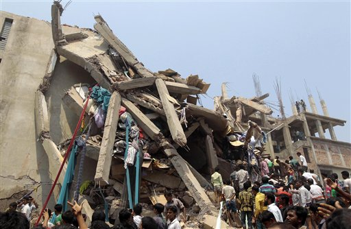 Rescue workers and people look for survivors after an eight-story building housing several garment factories collapsed in Savar, Bangladesh, on Wednesday. An enormous section of the concrete structure appeared to have splintered like twigs.