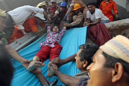 Rescuers lower down a survivor from the debris of the building that collapsed in Savar, Bangladesh, on Wednesday.
