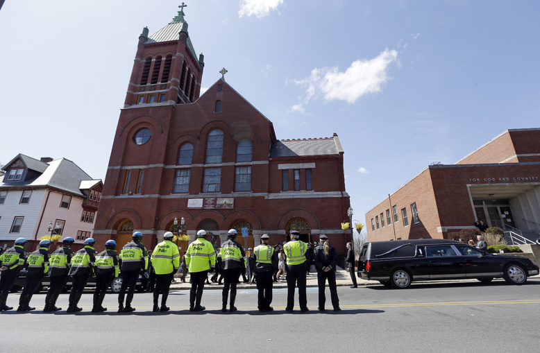 Medford and Somerville police line the street outside St. Joseph's Church in Medford, Mass., on Monday for the funeral of Boston Marathon bomb victim Krystle Campbell, 29.