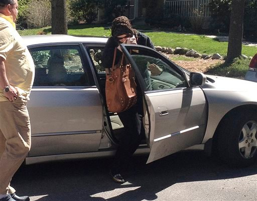 Katherine Russell Tsarnaev, wife of Boston Marathon bombing suspect Tamerlan Tsarnaev, exits a car at the home of her parents in North Kingstown, R.I., on Sunday. At left is her father, Warren Russell.