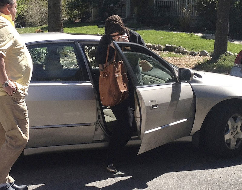 In this Sunday, April 21, 2013 photo, Katherine Russell Tsarnaev, center, wife of killed Boston Marathon bombing suspect Tamerlan Tsarnaev, exits a car at the home of her parents in North Kingstown, R.I. At left is her father, Warren Russell. (AP Photo/Katie Zezima) Boston Marathon Bombing Tsarnaev