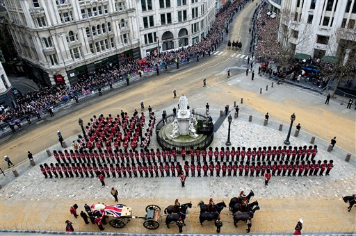 A Union flag draped coffin bearing the body of former British Prime Minister Margaret Thatcher is carried on a gun carriage drawn by the King's Troop Royal Artillery during her ceremonial funeral procession in London on Wednesday.
