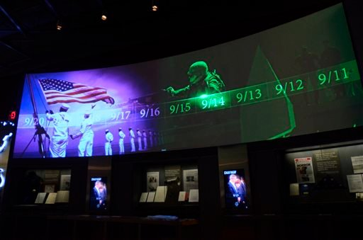 A screen displays images and video of the events and days that followed the 9/11 terrorist attacks as part of an exhibit in the museum area at the George W. Bush Presidential Library and Museum in Dallas.